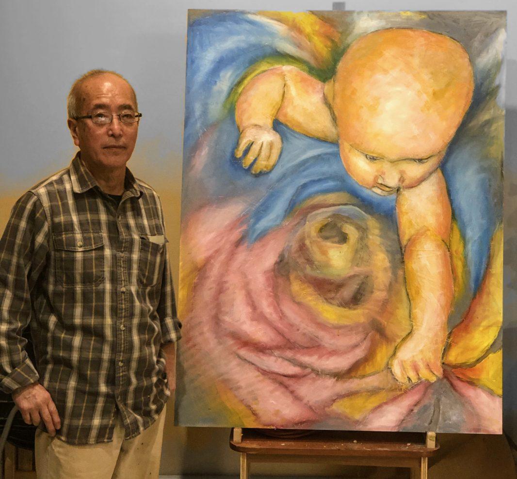 Aki Kumono with a painting