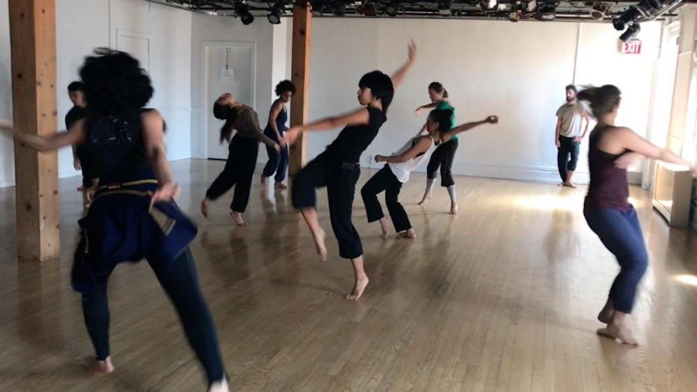 An adult dance class meets in BAX's theater to express themselves through movement.